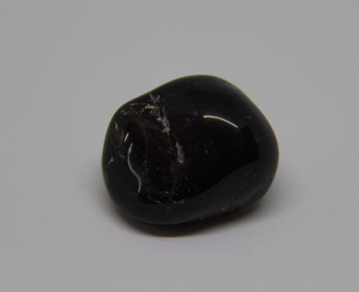 Pedra Ônix Preto Rolada - Helena Cristais